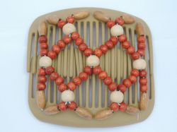 African Butterfly hair clip on blonde combs with orange and cream beads